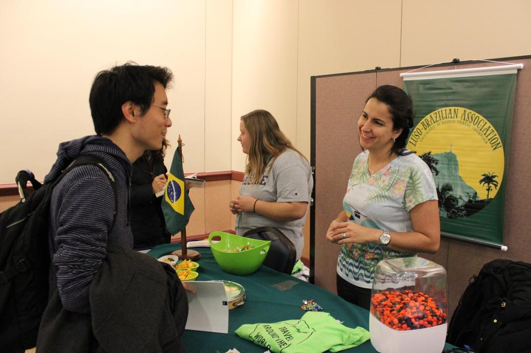 Raquel Goebel talks with a student